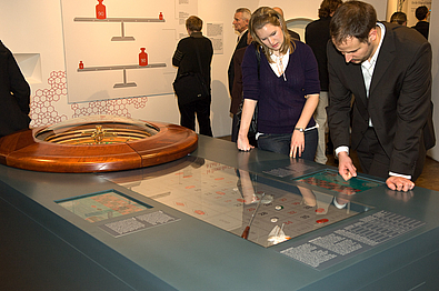 People playing roulette in the exhibition